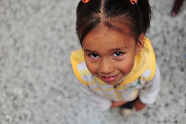 A young Colombian girl looks up