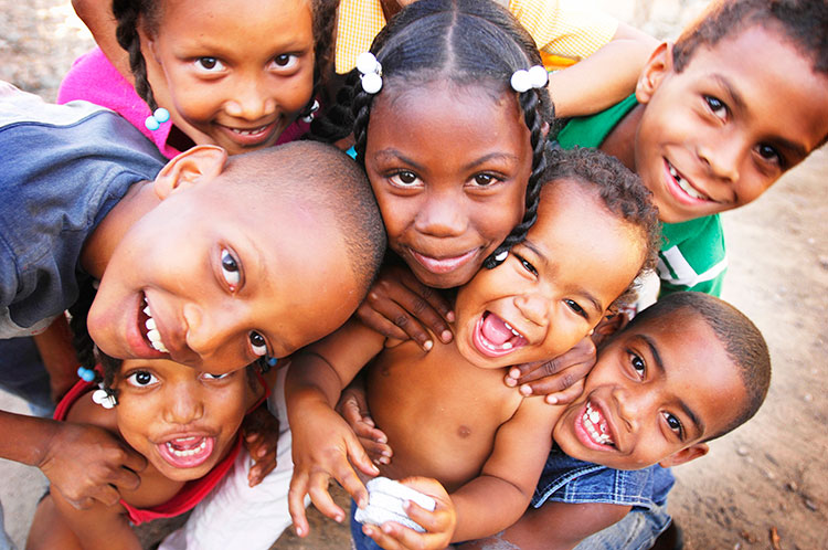 A group of Dominican children smiling and laughing