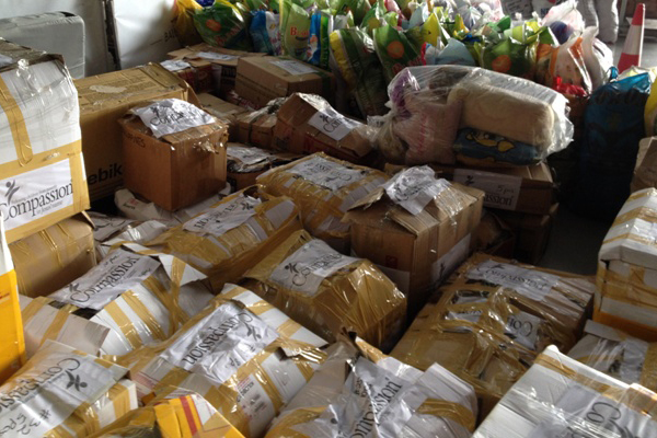 Boxes_of_relief_goods_packed_by_Compassion_country_office_staff_2.jpg