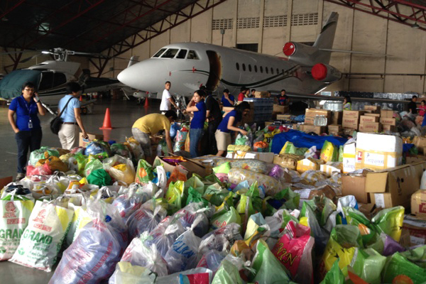 Country_office_volunteers_packing_relief_goods_to_be_sent_on_a_military_plane_1.jpg