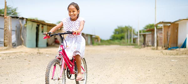 Peru_girl-riding-a-bike_600x270