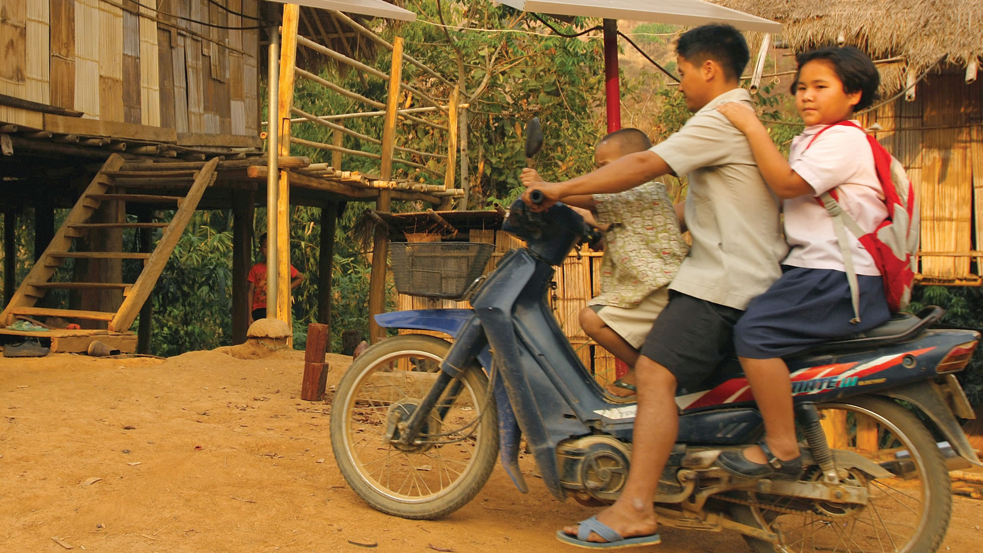 Piyaporn rides a motorcycle with her father