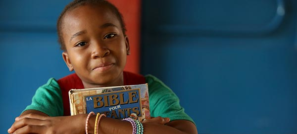 A child holding a Bible