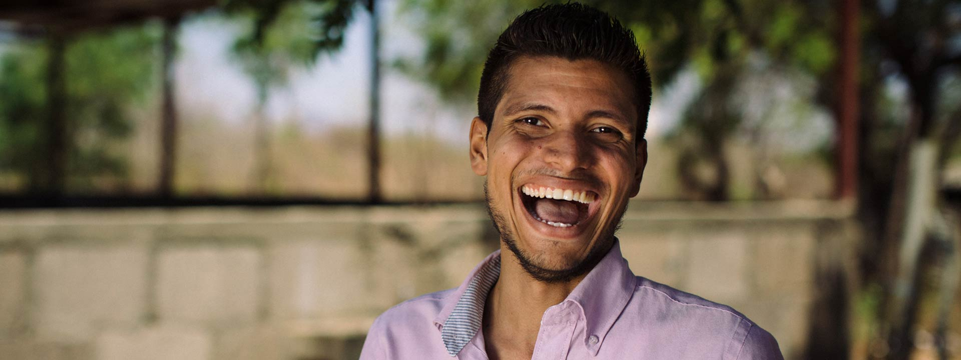 Oscar smiles while working at the church he pastors