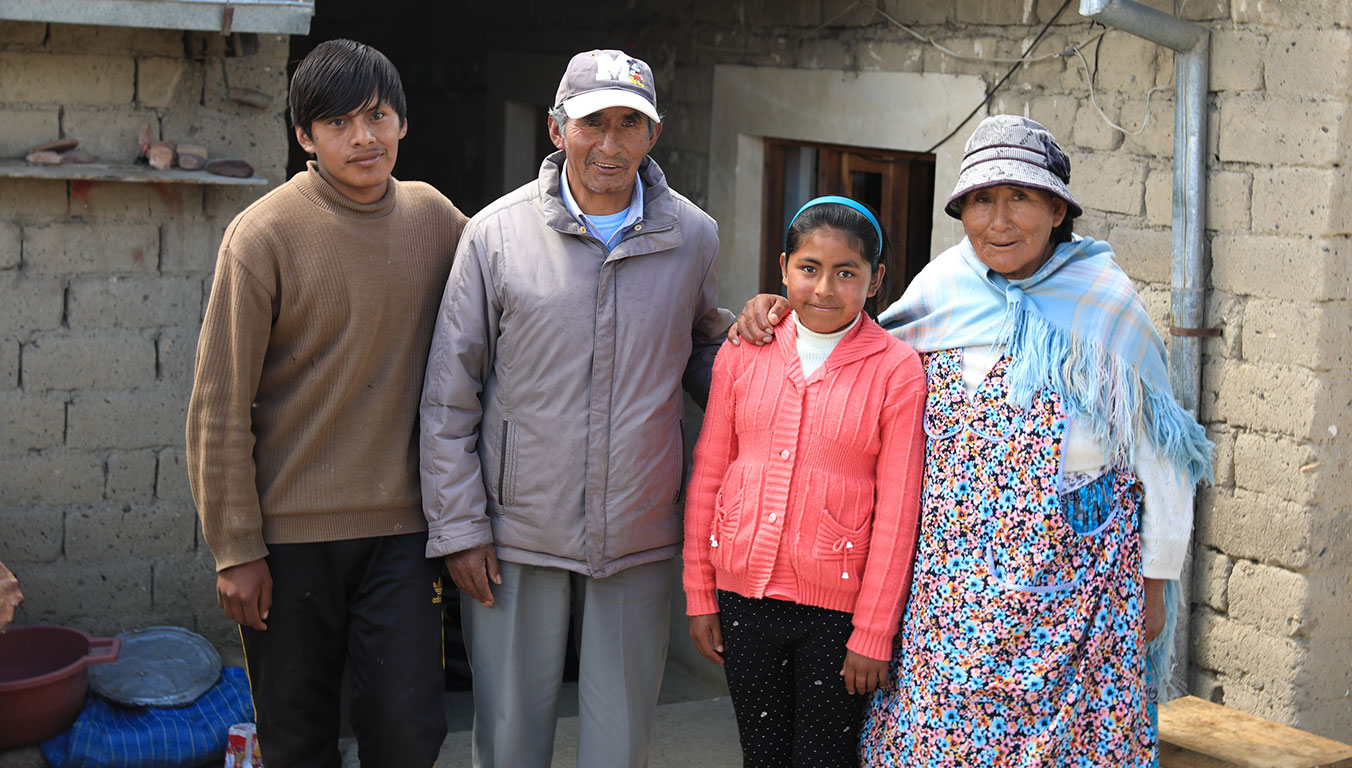 From left, Carlos, Pablo, Nayely and Pasesa outside their adobe home that Pablo built.