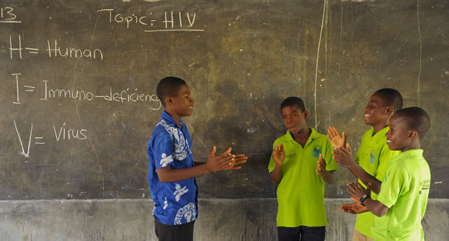 Hiv And Aids Facts  Compassion International Boys Learning About Hiv In School Write Assignment For You also Help With Acadimic Research $10  Samples Of Essay Writing In English
