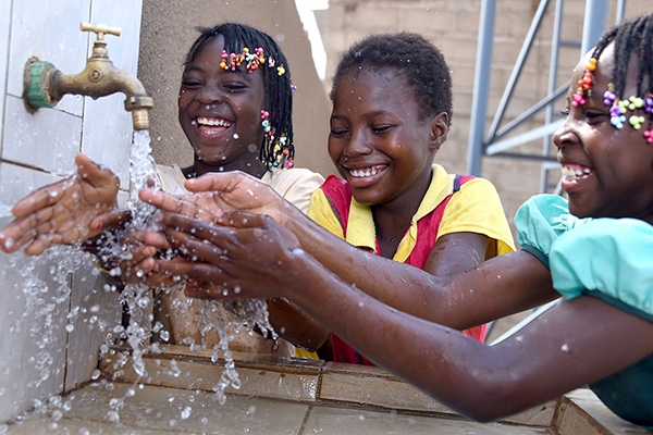 Girls at a Burkina Faso Compassion center washing hands