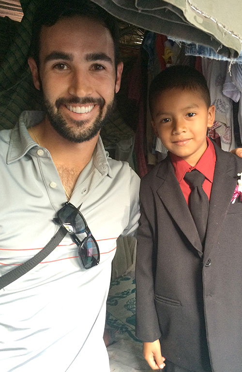 Cameron with a boy he met in El Salvador