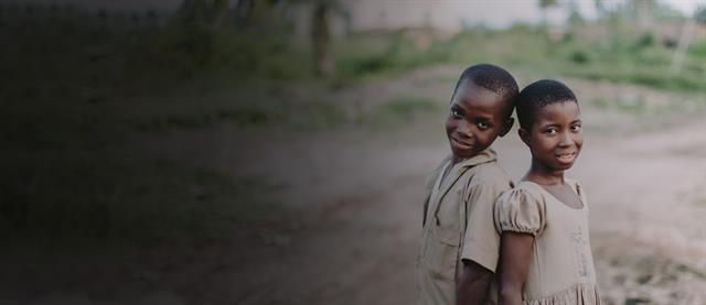 A boy and a girl standing together in Togo