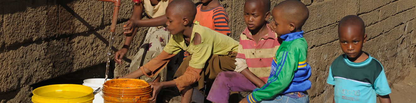 Children filling buckets with clean water