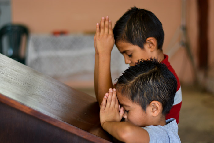 Two boys pray