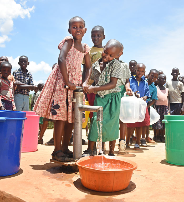 Kids pour clean water