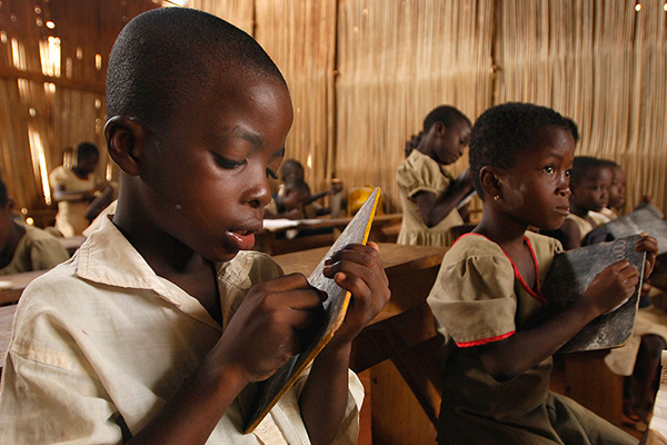 Children writing on tablets in school