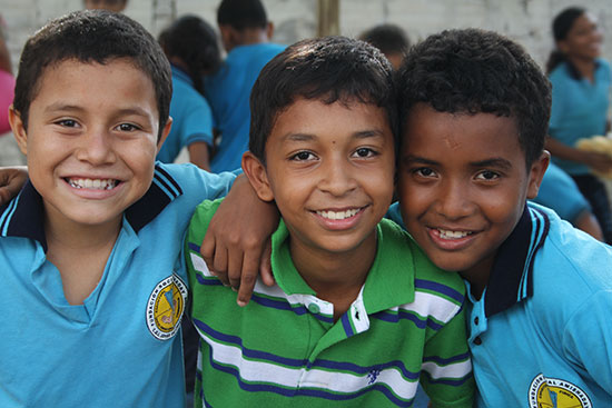 Three young boys smiling