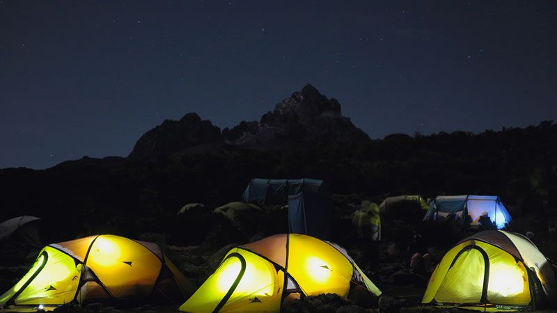 Sponsors sleep in tents under the starry sky
