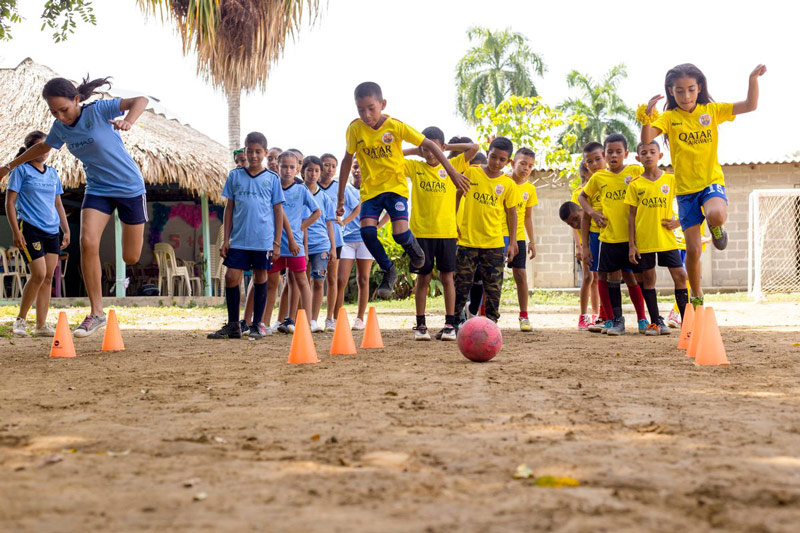 Children learn soccer skills at their child development center
