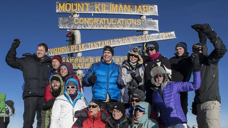 Compassion sponsors celebrate their climb to the summit of Mount Kilimanjaro