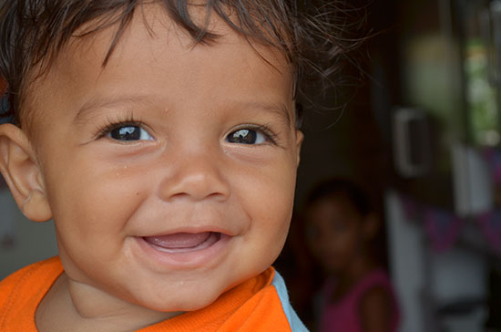 A smiling Brazilian toddler