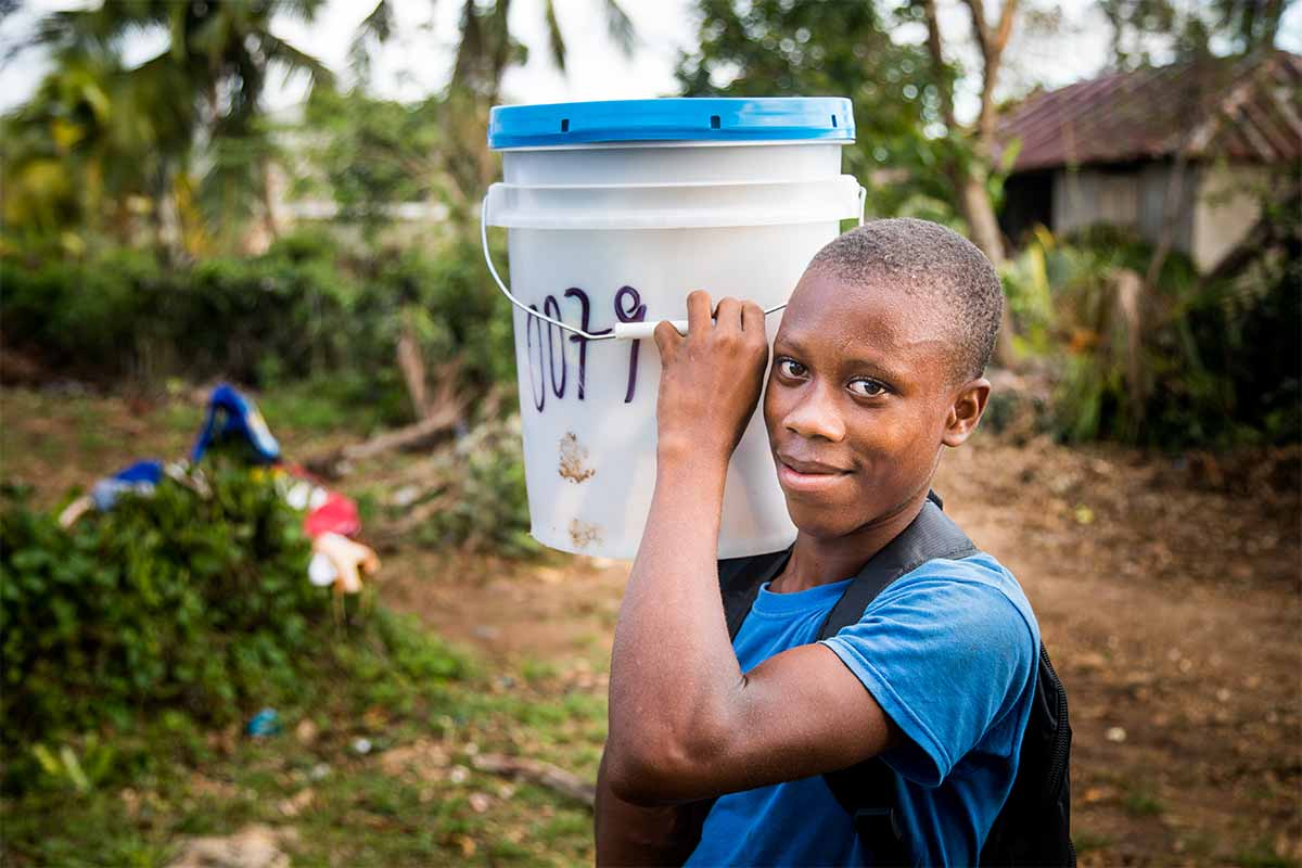 A young man carrying disaster relief supplies