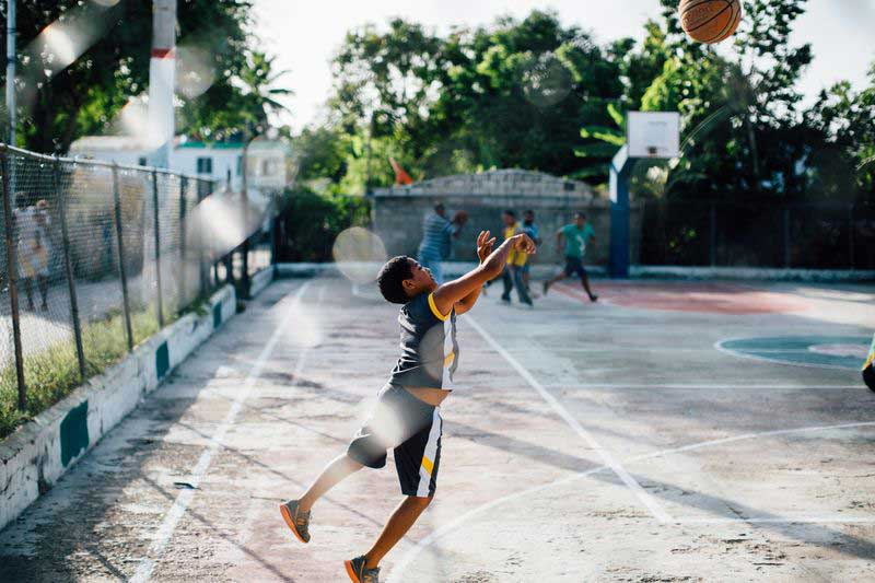 A boy shoots a basketball