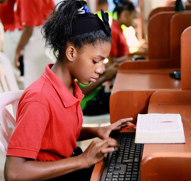A girl working on the computer in her school