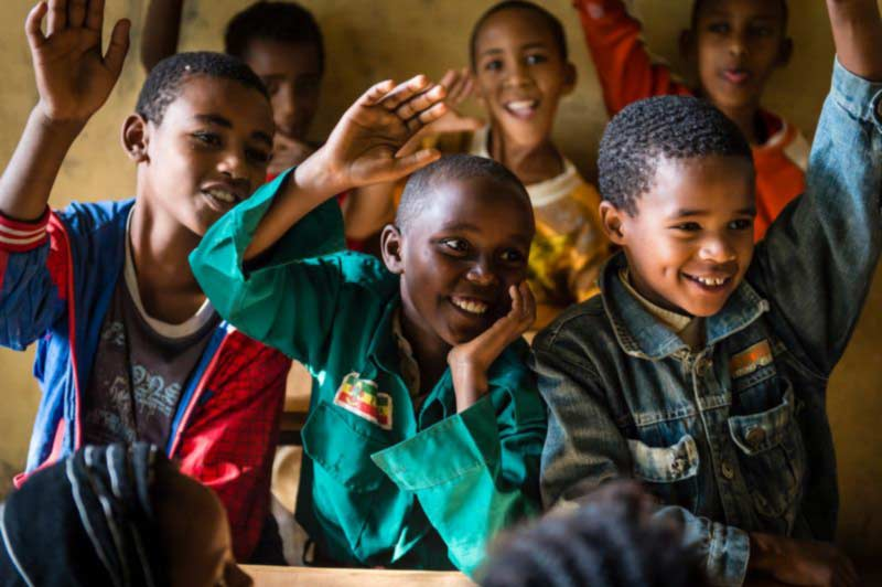 Children happily engage in the classroom