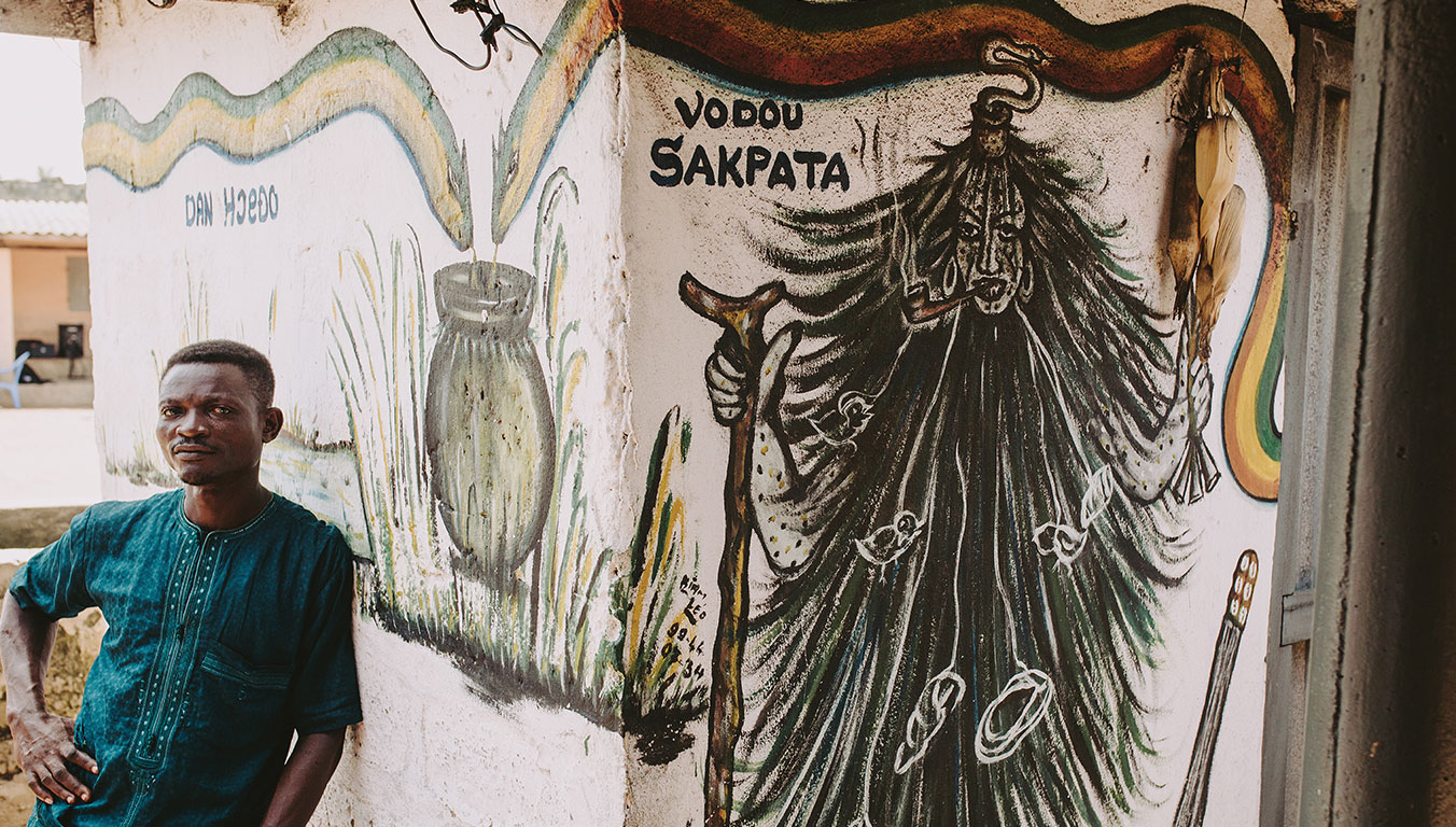 Aklobessi's father standing outside a Voodoo shrine