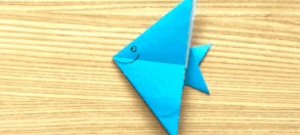 a folded origami paper fish