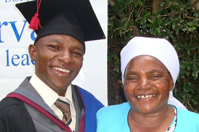 Joshua and his mother celebrating his graduation