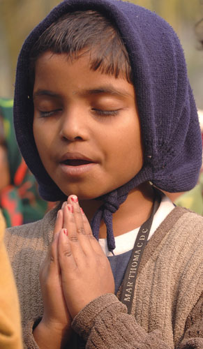 A girl folding her hands and praying