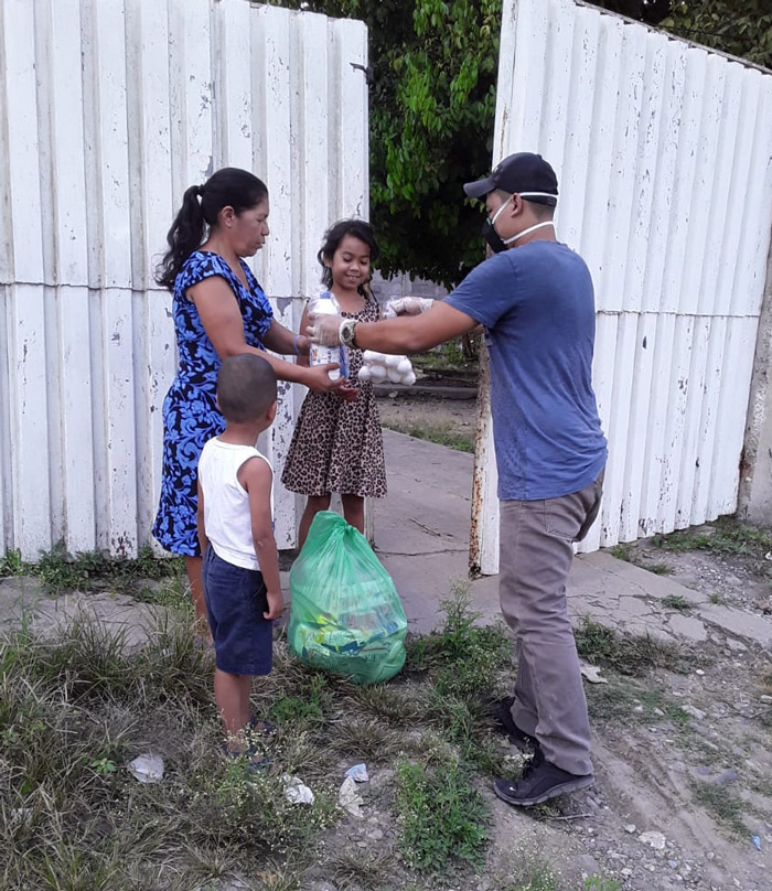 a family carrying dry goods