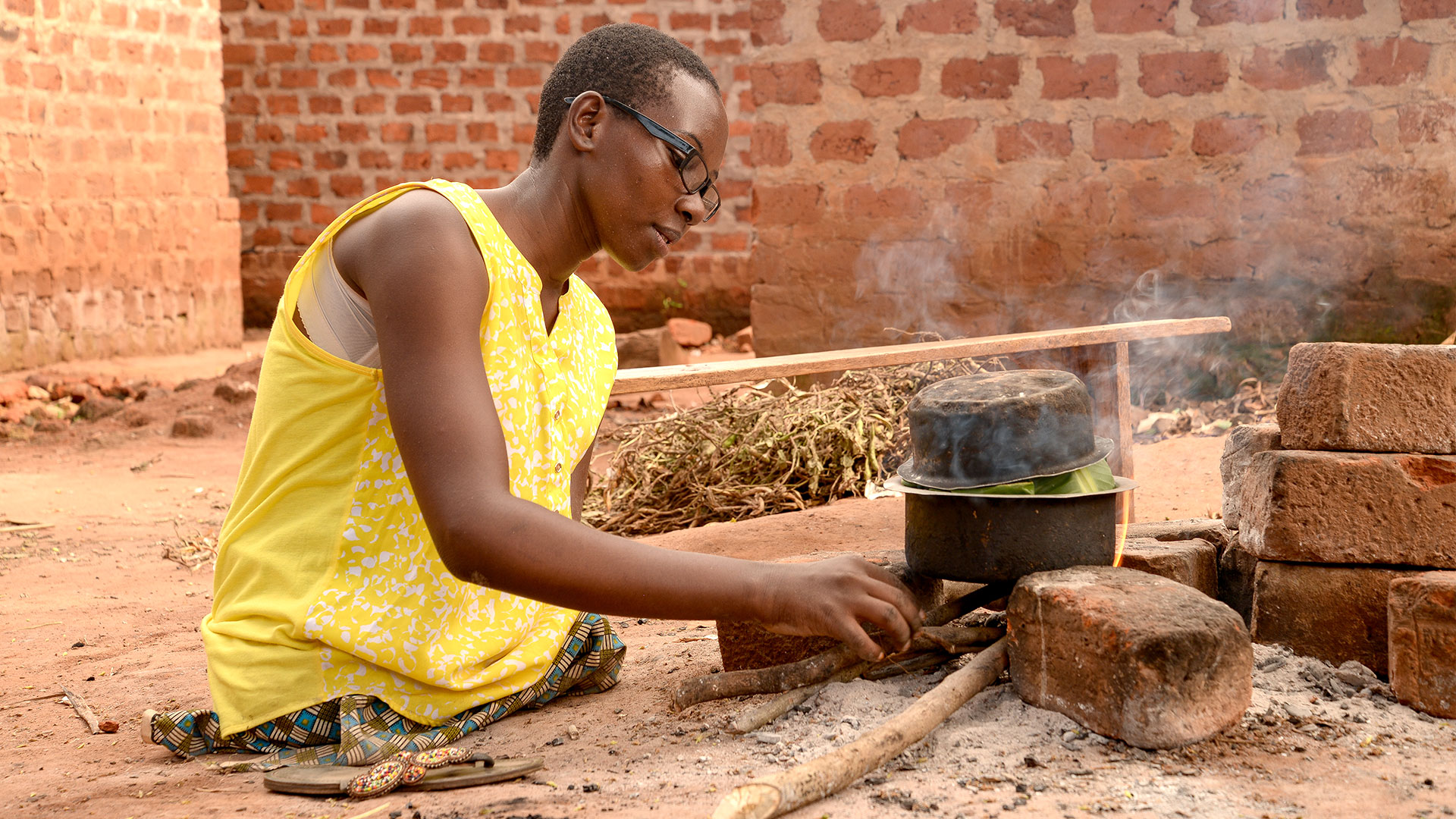 Grace prepares a meal on her outdoor stove.