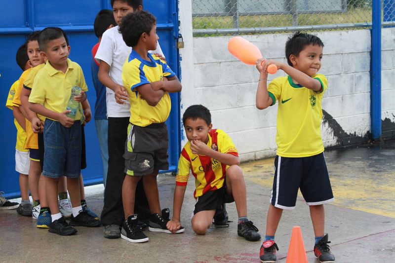 A group of boys play baseball at their child development center