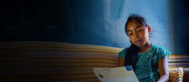 A girl reading her letter