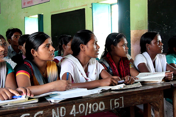 Girls learning in class at university in India