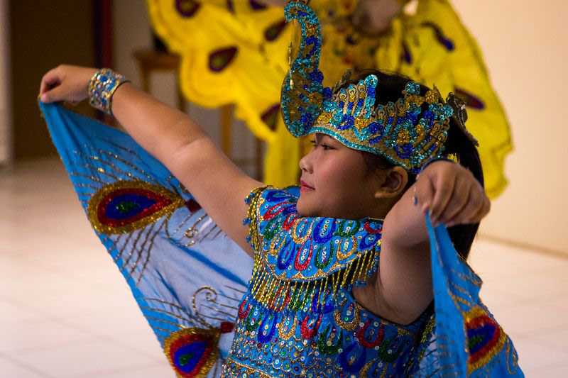A young girl performs a cultural dance