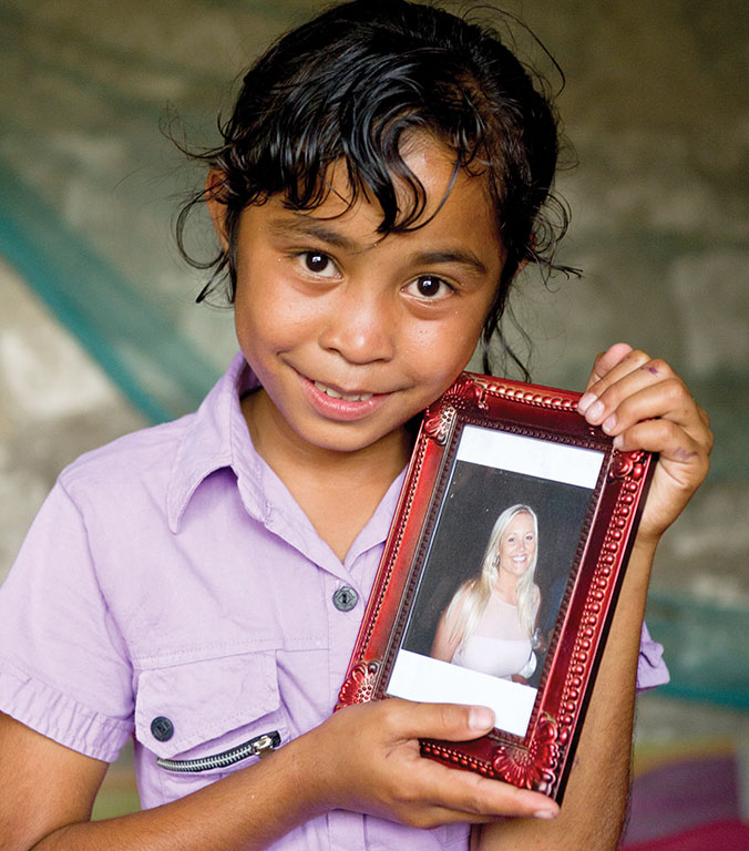 Halena holding a photo of her sponsor