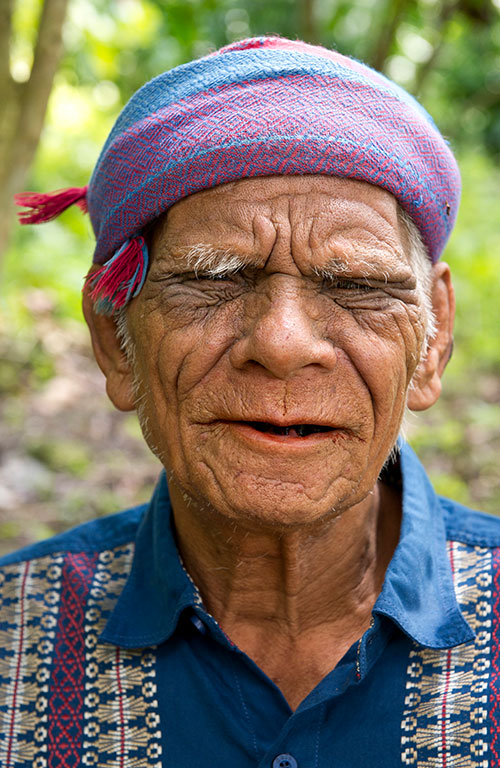 A male Sumba member wearing a purple head covering