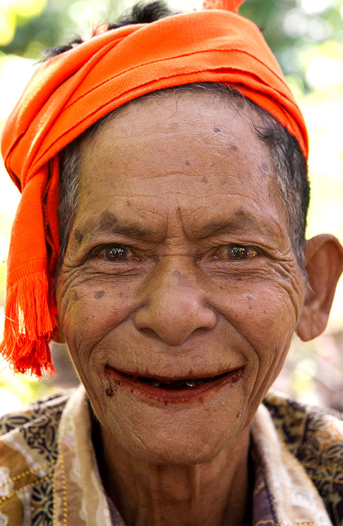 An older male of the Sumba tribe wearing an orange head covering