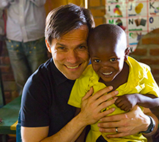 "Santiago ""Jimmy"" Mellado with a Compassion child"