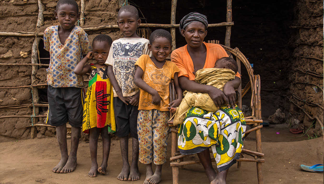 A Kenyan Family gathered together in front of their house