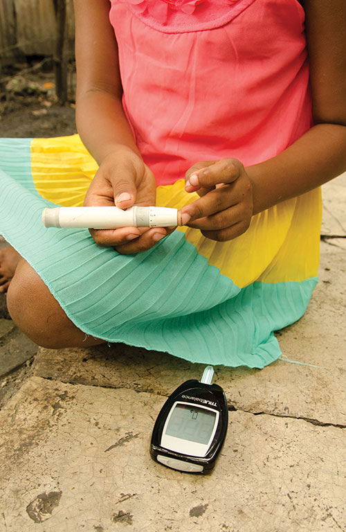 Leoneri uses a device to measure her blood sugar