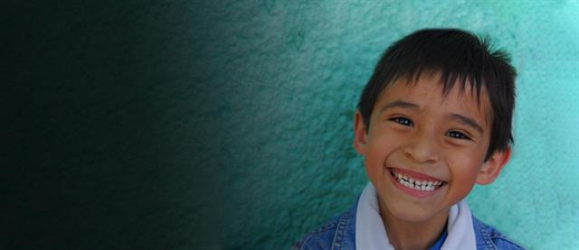 A boy from Mexico smiling