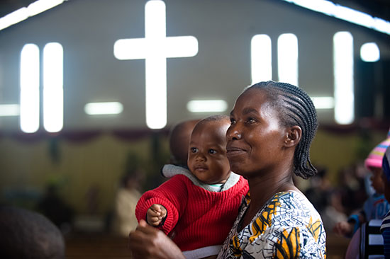 A mom holding her child while attending church