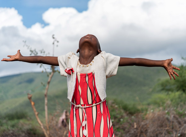 A young girl with her arms stretched out