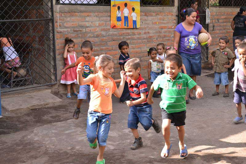 Children laugh and play together at their child development center