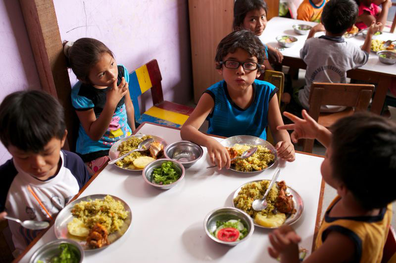 Children eating a nutritious meal at their child development center