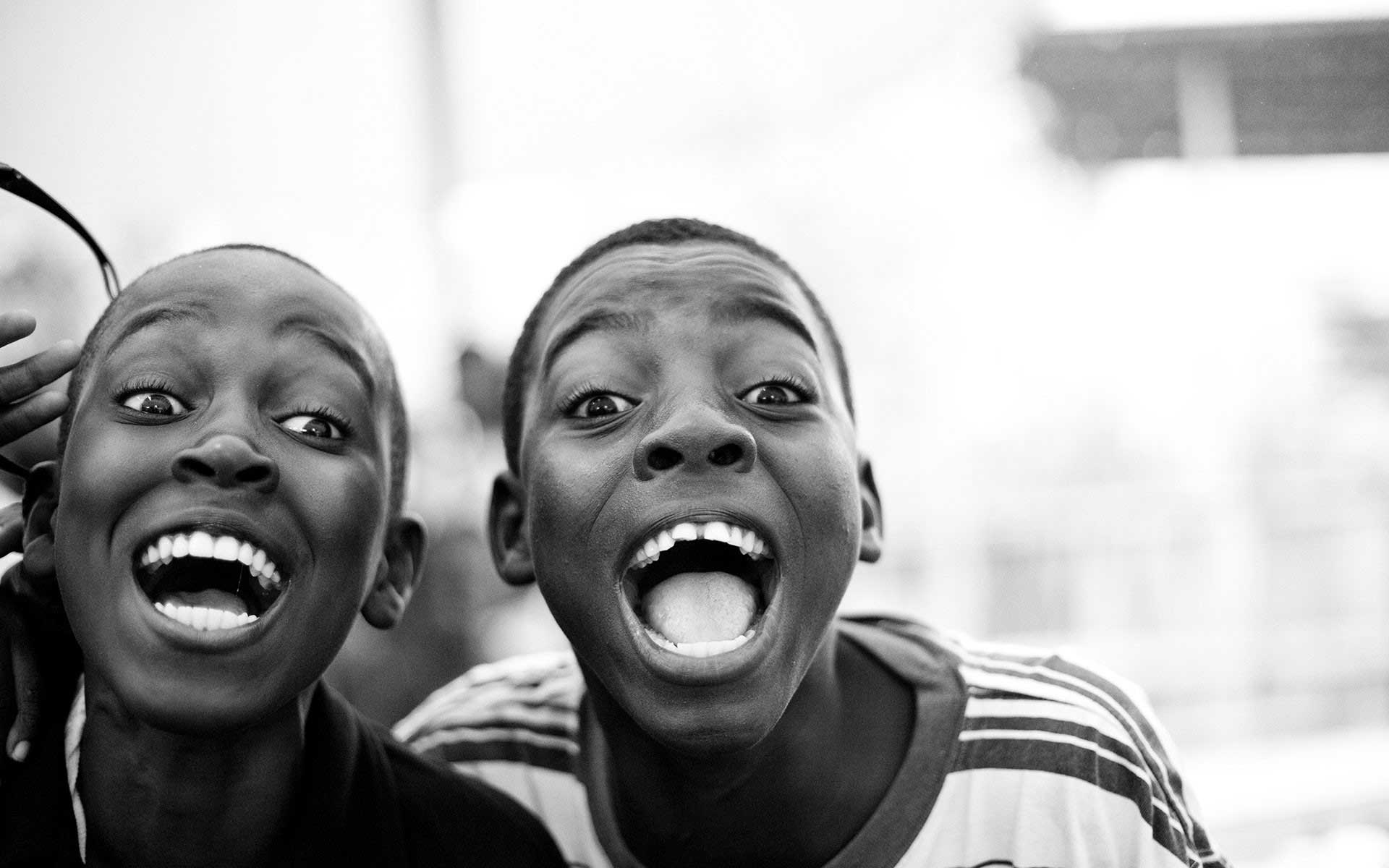 Two Haitian boys laughing together