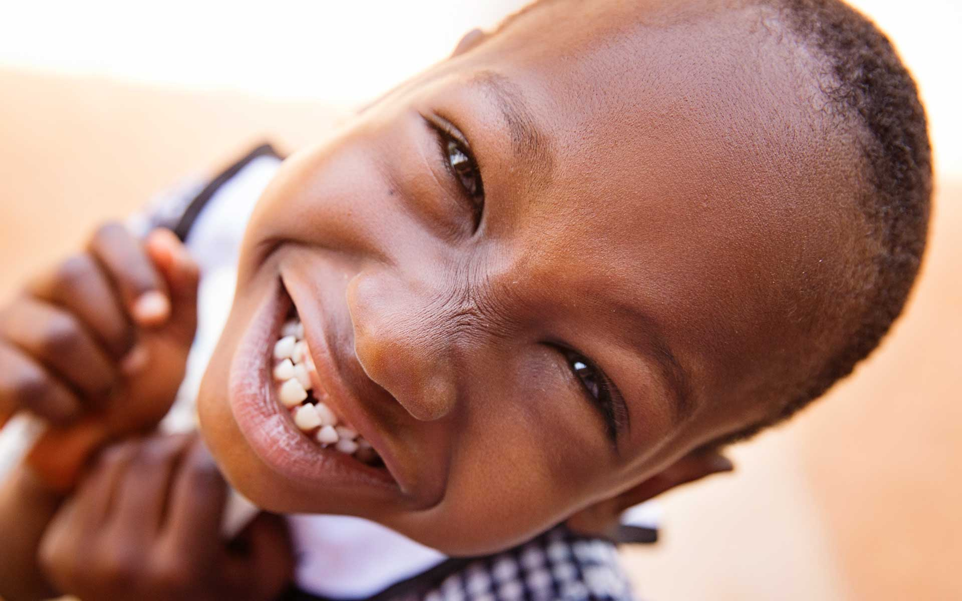 A girl from Burkina Faso smiling