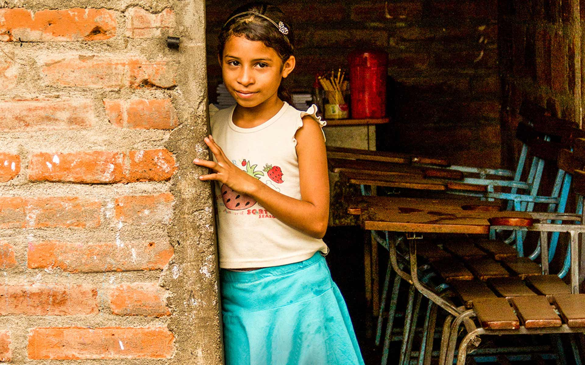 A girl standing in the doorway of her classroom